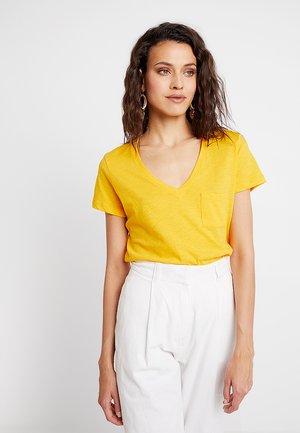 WHISPER V NECK POCKET TEE - Basic T-shirt - yellow