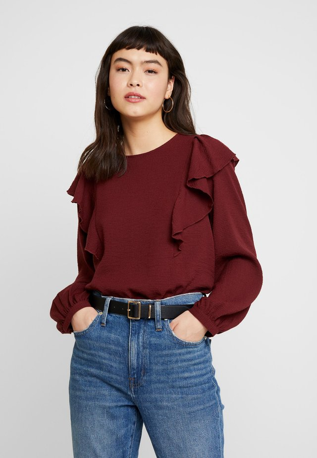 SOLID RUFFLE - Bluse - dark cabernet