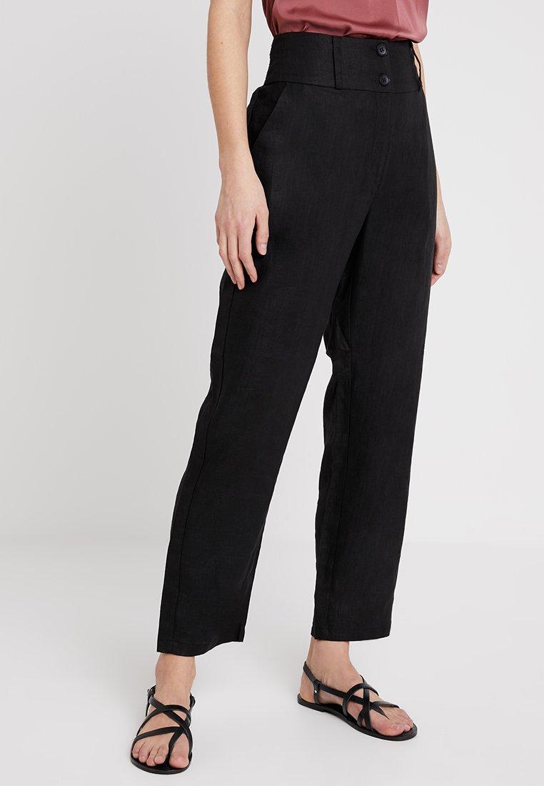 Masai - PETRONI TROUSERS - Trousers - black