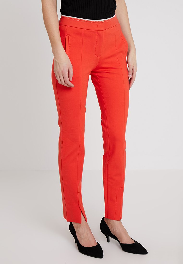 Marc O'Polo PURE - PANTS FIT SLIT DETAIL AT HEM - Trousers - strong scarlet