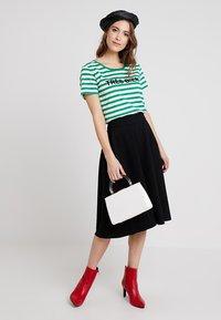 Marc O'Polo PURE - SKIRT CIRCLE SILHOUETTE - A-line skirt - black - 1