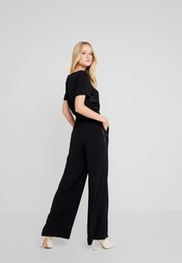 Marc O'Polo PURE - OVERALL SHORT SLEEVE WIDE LEG - Jumpsuit - pure black - 2