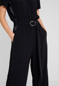 Marc O'Polo PURE - OVERALL SHORT SLEEVE WIDE LEG - Jumpsuit - pure black - 6