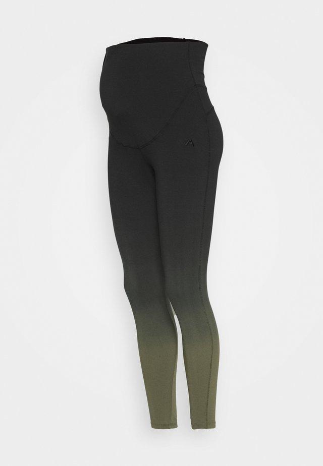 FEELING COSMIC - Leggings - black