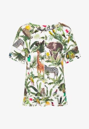 T-shirts med print - grün