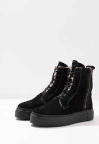 MAHONY - HELSINKI - Platform ankle boots - black - 4