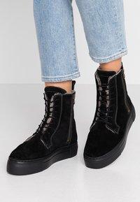 MAHONY - HELSINKI - Platform ankle boots - black - 0