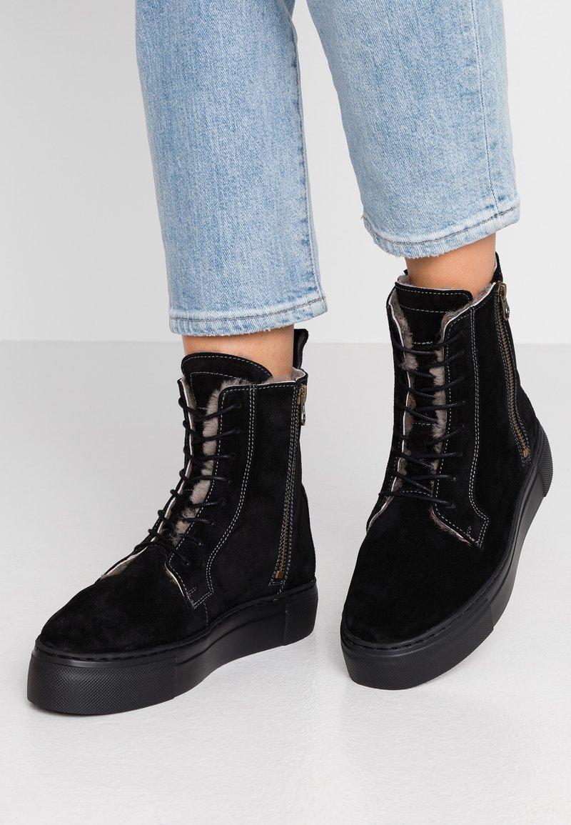 MAHONY - HELSINKI - Platform ankle boots - black