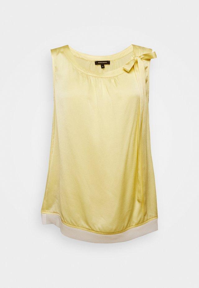 Top - pastel yellow