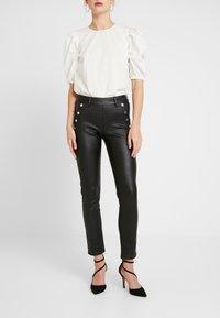 Morgan - POETE.N - Pantalon classique - black - 0