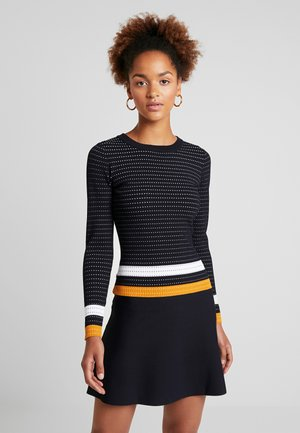 Stickad klänning - marine/fauve