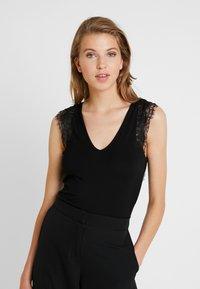 Morgan - DUNE - T-shirt med print - noir - 0