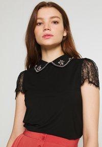 Morgan - T-shirt imprimé - noir - 0