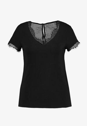 DMINOL - T-shirts med print - noir
