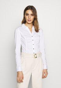 Morgan - CARA - Button-down blouse - blanc - 0