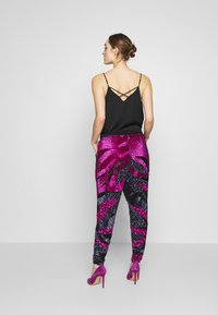 MANÉ - SOFIA TROUSERS - Trousers - washed black/magenta - 2