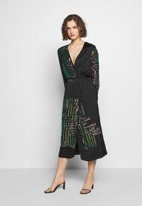 MANÉ - MAZE WRAP DRESS - Cocktail dress / Party dress - washed black/rose - 0