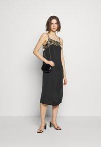 MANÉ - NOCTIS DRESS - Cocktail dress / Party dress - washed black/gold - 1