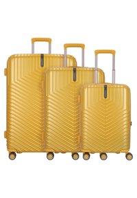 march luggage - LOTUS 4-ROLLEN 3TLG. - Luggage set - golden honey metallic - 0