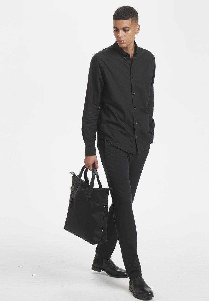 Matinique - Tote bag - black