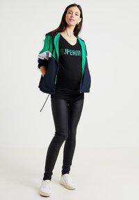 MAMALICIOUS - MLRAM COATED - Jeans slim fit - black - 1