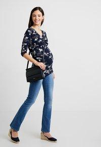 MAMALICIOUS - MLMILTON FLARE - Jeans Bootcut - light blue denim - 1