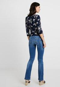 MAMALICIOUS - MLMILTON FLARE - Jeans Bootcut - light blue denim - 2