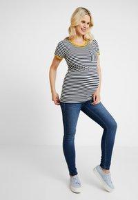 MAMALICIOUS - MLGLOBE ANKLE - Slim fit jeans - medium blue denim - 1