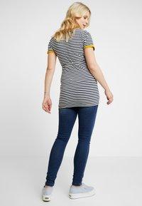 MAMALICIOUS - MLGLOBE ANKLE - Slim fit jeans - medium blue denim - 2