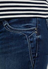 MAMALICIOUS - MLGLOBE ANKLE - Slim fit jeans - medium blue denim - 5