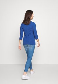 MAMALICIOUS - MLLARGO - Slim fit jeans - light blue denim - 2