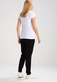 MAMALICIOUS - MLLIF  - Spodnie treningowe - black - 2
