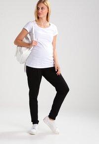MAMALICIOUS - MLLIF  - Spodnie treningowe - black - 1