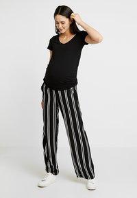 MAMALICIOUS - MLEBONY PANTS - Trousers - salute - 1