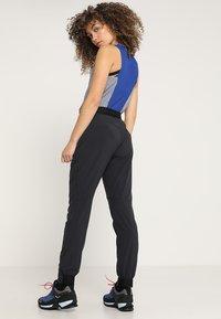 Mammut - CRASHIANO PANTS WOMEN - Outdoorbroeken - black - 2