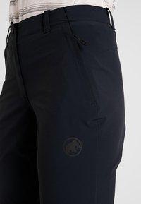 Mammut - RUNBOLD ZIP OFF PANTS WOMEN - Trousers - black - 4