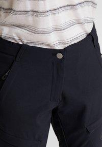 Mammut - ZINAL PANTS WOMEN - Długie spodnie trekkingowe - black - 5