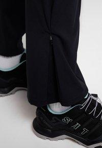 Mammut - ZINAL PANTS WOMEN - Długie spodnie trekkingowe - black - 4