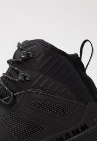 Mammut - DUCAN PRO HIGH GTX MEN - Winter boots - black/titanium - 5