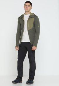 Mammut - COURMAYEUR PANTS MEN - Outdoor trousers - black - 1