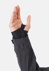 Mammut - STONEY - Ski jacket - black - 11