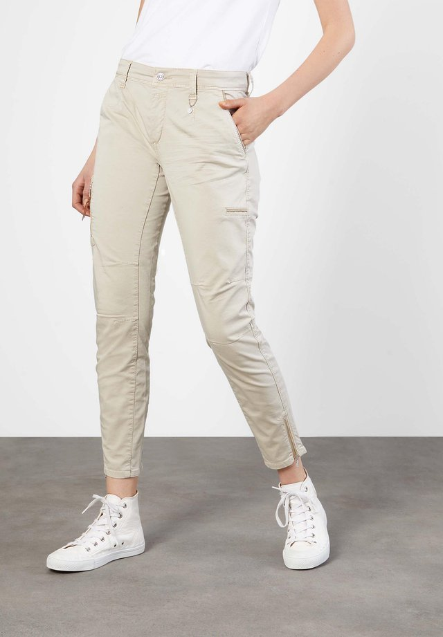 RICH - Trousers - sand