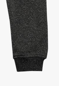 Molo - ALIKI - Pantalones deportivos - silver/black - 2