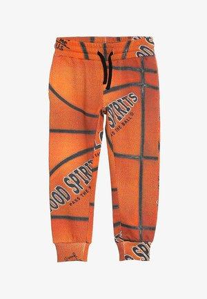 ALCAN - Teplákové kalhoty - orange