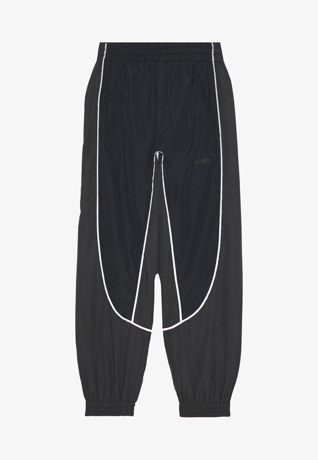 ARKUU - Pantaloni sportivi - black