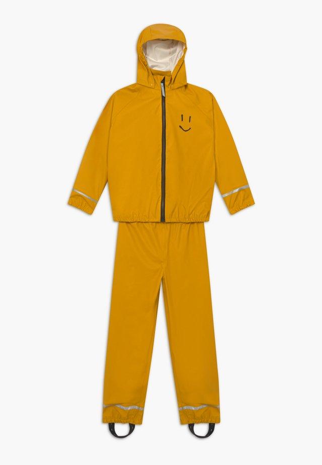 ZET SET - Waterproof jacket - nugget gold