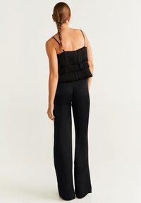 Mango - PALAZZO - Spodnie materiałowe - black - 2