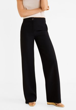 SIMON - Trousers - black