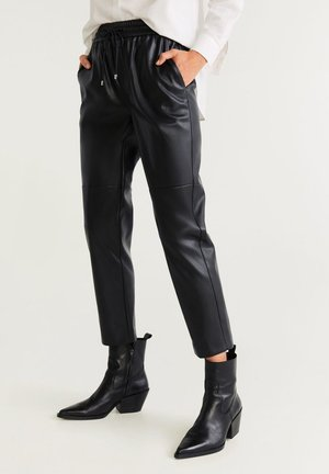 APPLE - Trousers - black