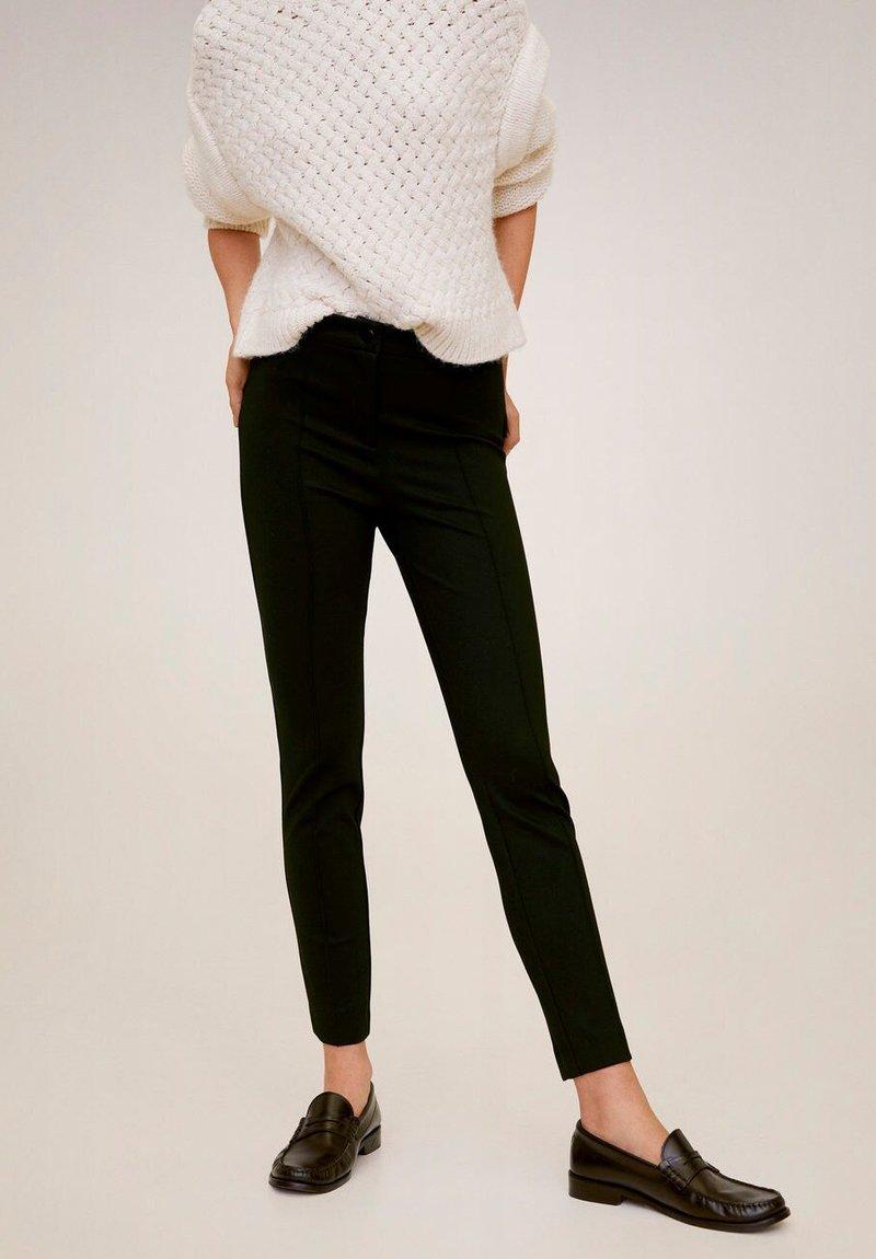Mango - LIMA - Trousers - black